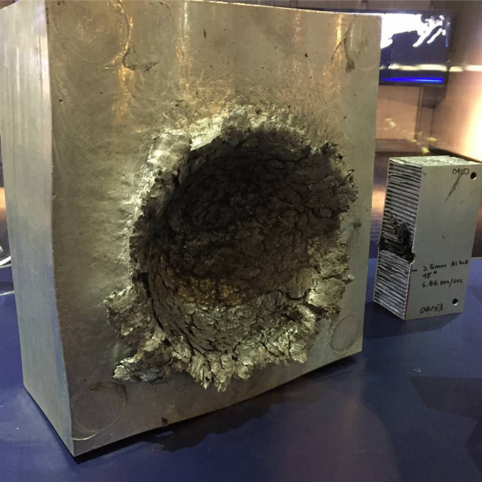 this is what happens to aluminium when a 1/2 oz piece of plastic hits it at 15000 mph in space