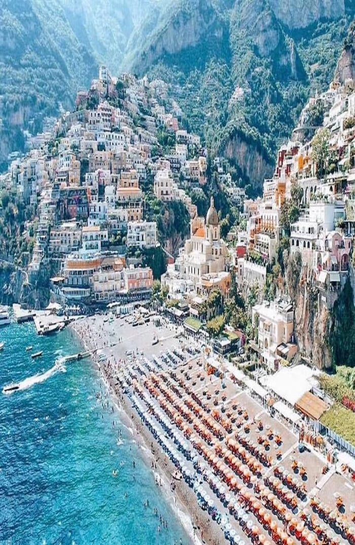 positano italy, picturesque beach town built into the hillside