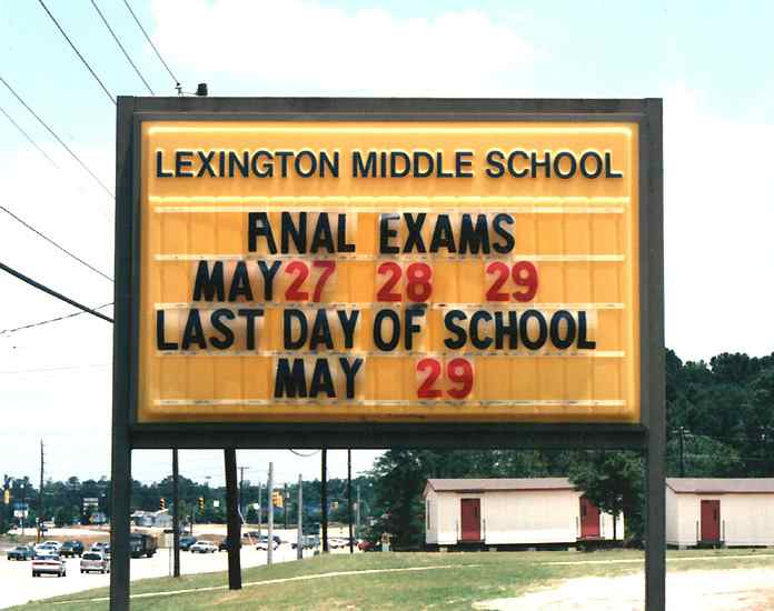 lexington middle school anal exams, school sign vandalism win