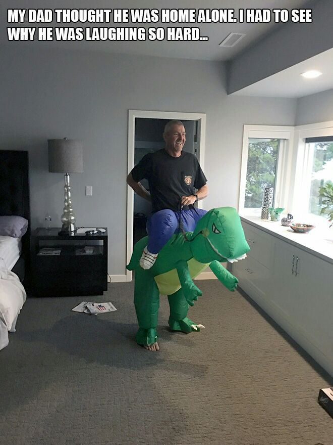 my dad thought he was home alone, i had to see why he was laughing so hard, man riding dinosaur costume