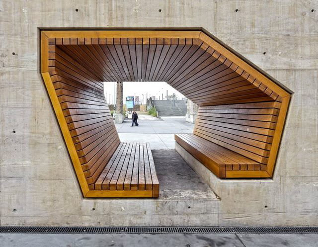 bench through concrete wall, cool architecture