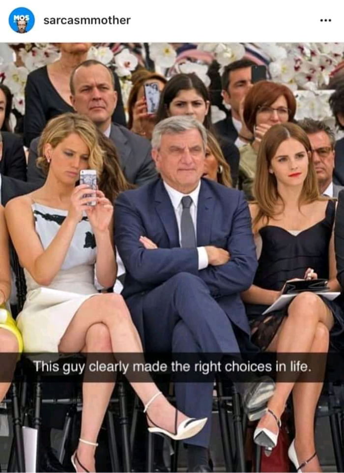 this guy clearly made the right choices in life, sitting between jennifer lawrence and emma watson