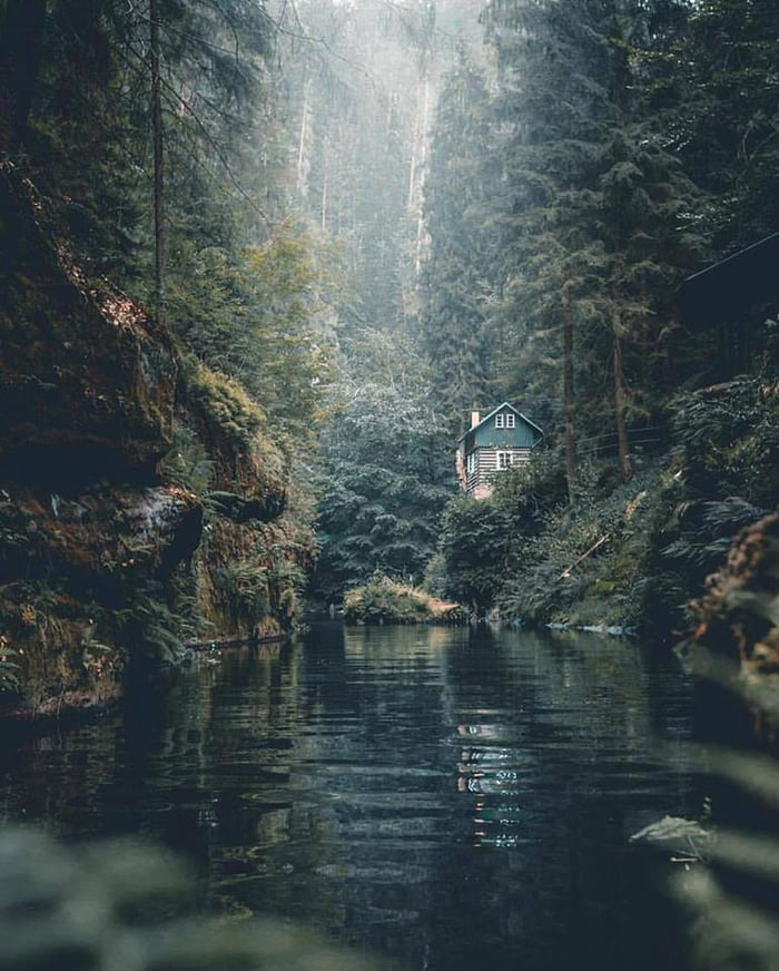 just a little house in the woods by a river, beautiful scenery