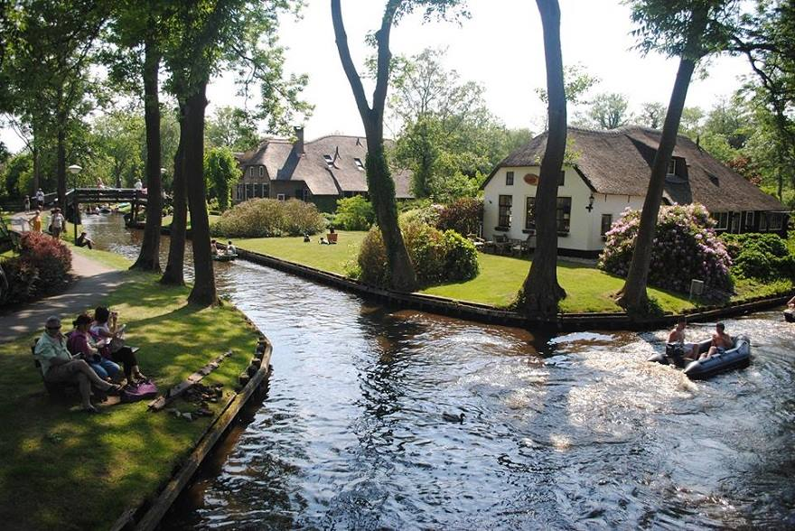 giethoorn in netherlands has no roads or any modern transportation at all, only canals
