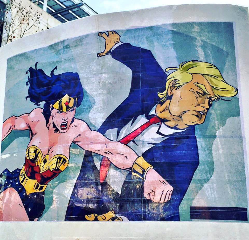 wonder woman punching donald trump street art