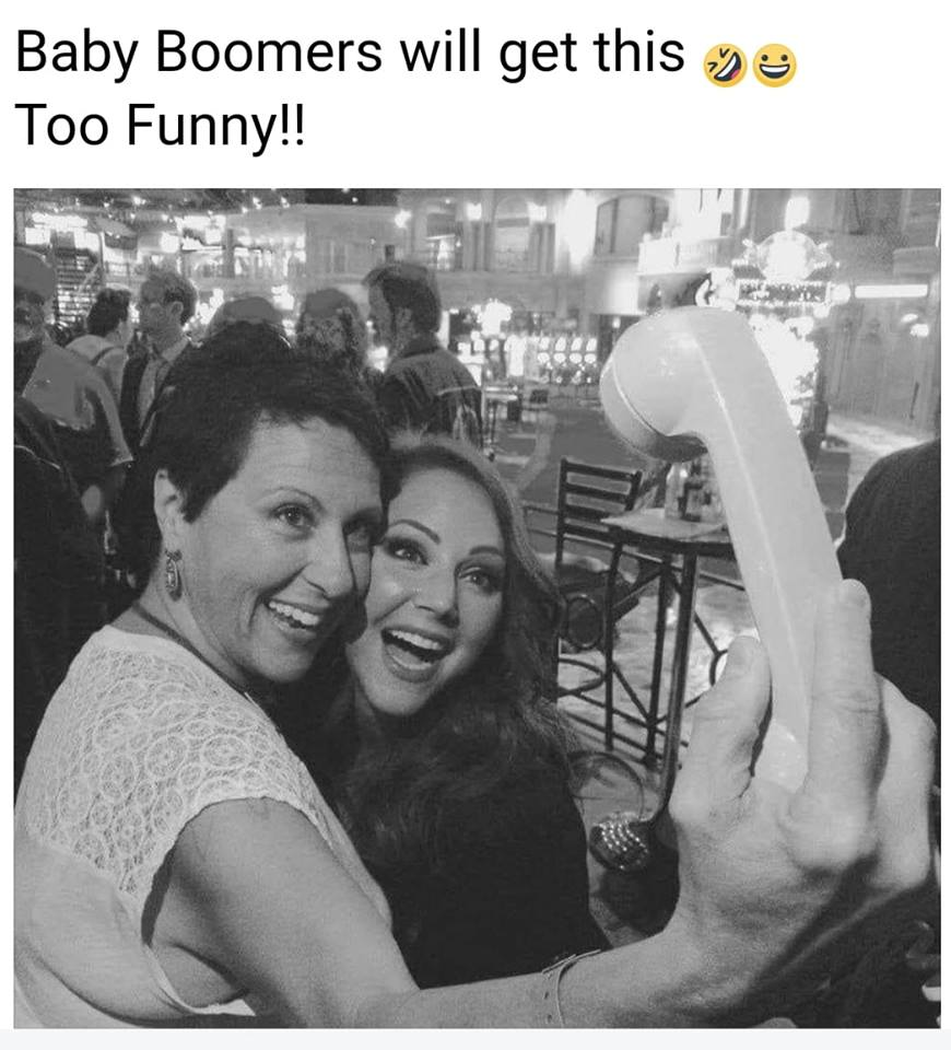 taking a selfie with your phone, baby boomers will get this